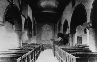 Photograph of the inside of St Oswalds church taken before the removal of the box pews in 1870
