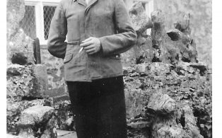 Photograph dated 1945 of George Schwensburg, German POW at Lodge Hall Farm
